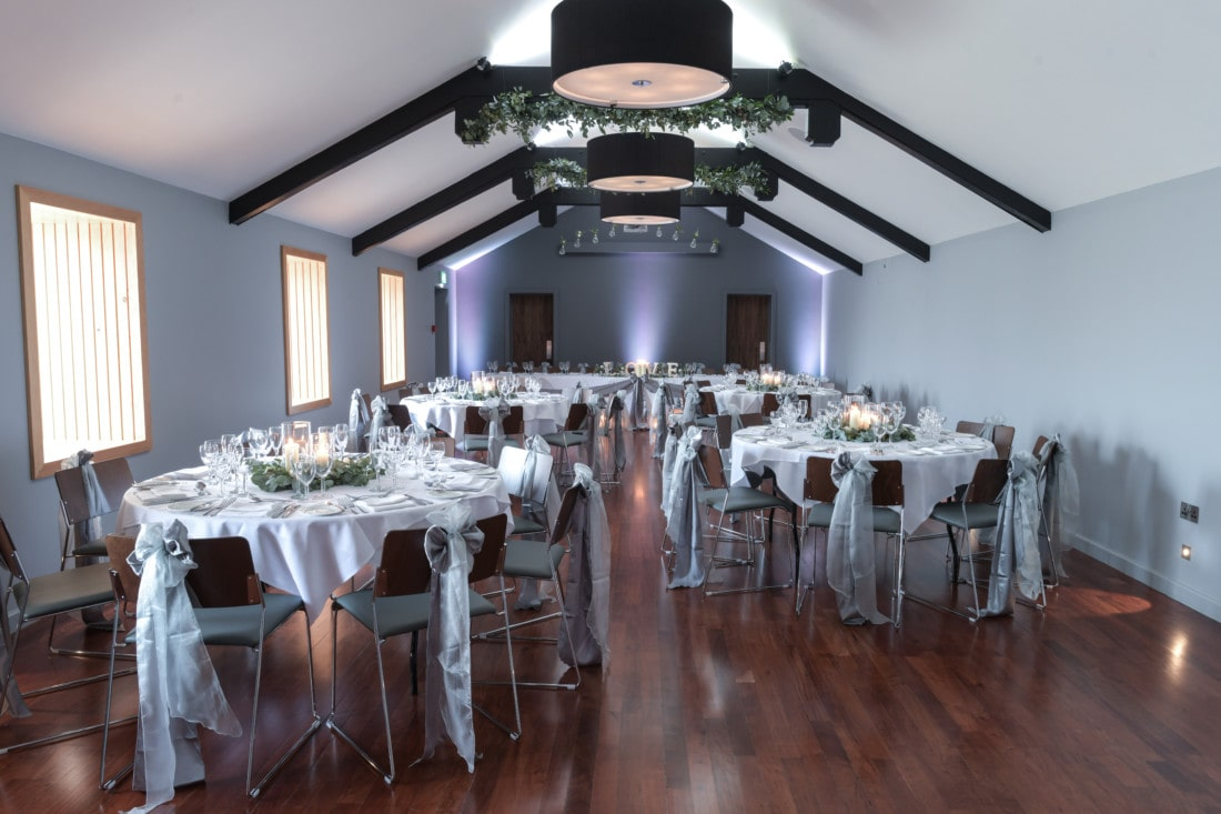Function room dining tables at Exeter wedding venue in Devon