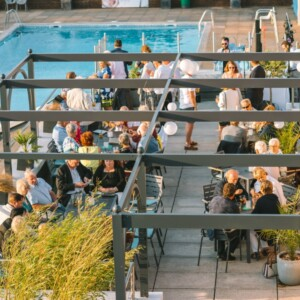 guests in outdoor party area by pool at Exeter wedding venue