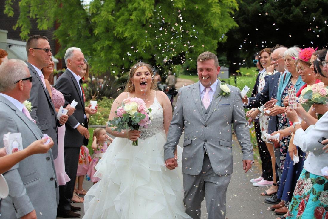 confetti being thrown at Exeter wedding venue in Devon